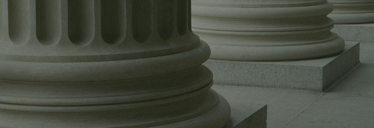 The bases of three stone columns
