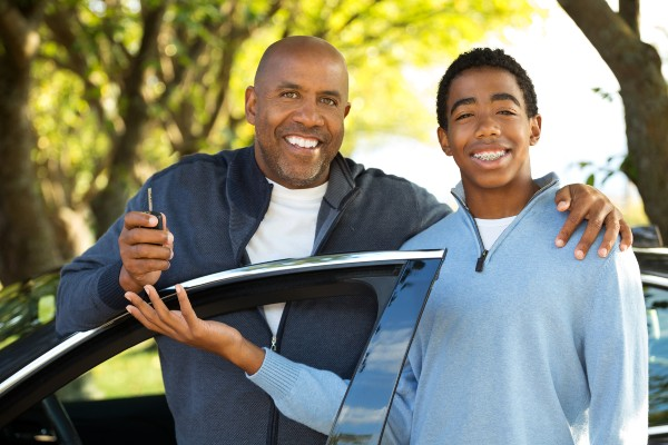Father teaching his son how to drive | CDOT Graduated Drivers License Laws